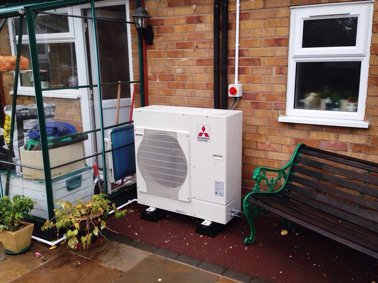 image of air source heat pump fitted in garden