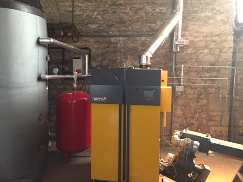 image of boiler tank and pump fitted in barn