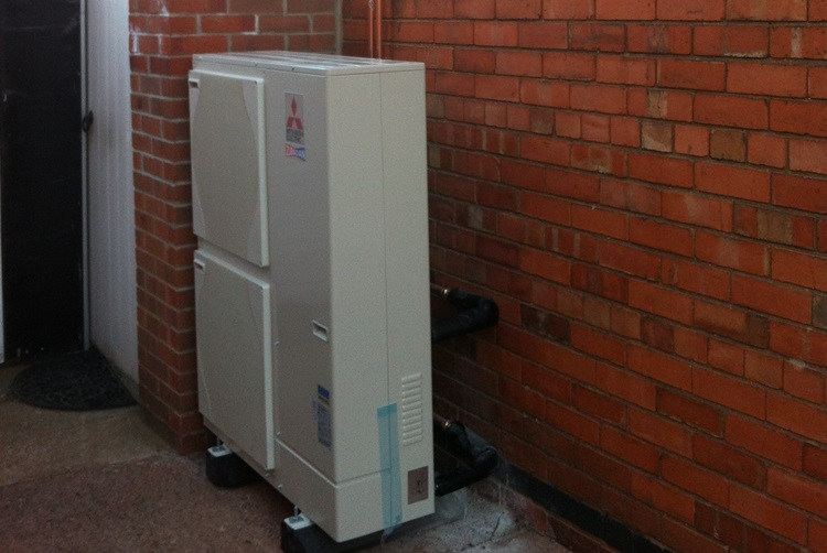 image of air source heat pumps fitted around rear of house