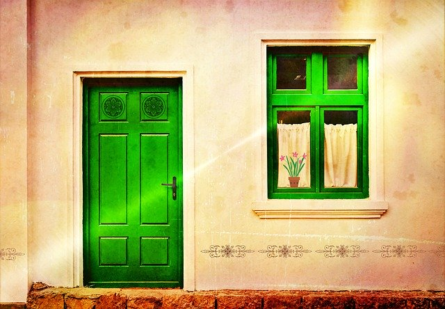 image of a green front door and window representing types of insulation for your home