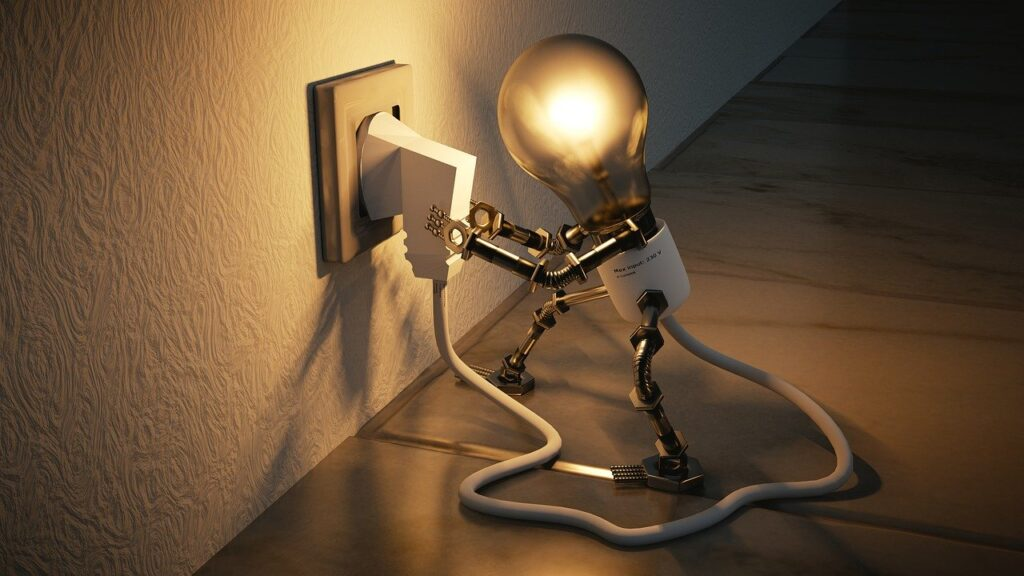image of light bulb plugging itself in representing how we can save energy while staying home