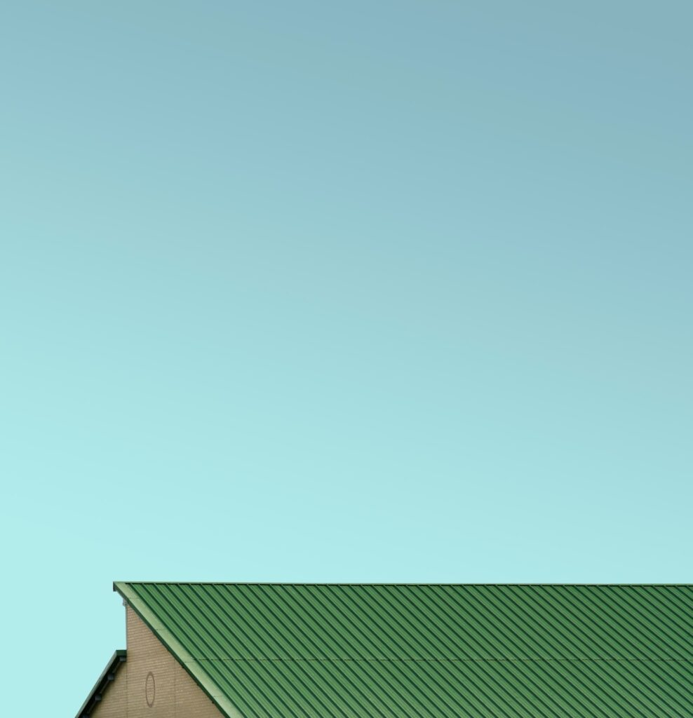 Biomass boiler overheating, green roof top with greenish blue sky in the background