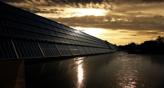 Solar Panel Problems; Solar panels installed around a water body.